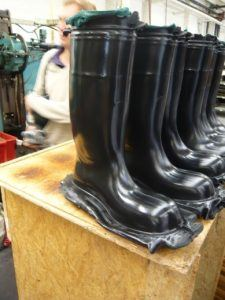 Rubber boots manufactured by compression molding