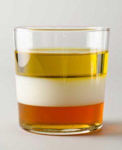 Immiscible liquids in separed layers: milk, baby oil