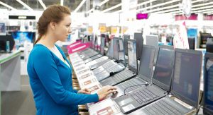 solidworks requirements. woman shopping for a laptop.