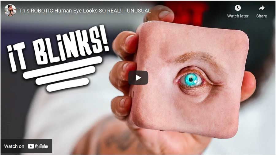 super realisitc robotic human eye - a phot of a realistically looking eyeon a block of artificial human skin